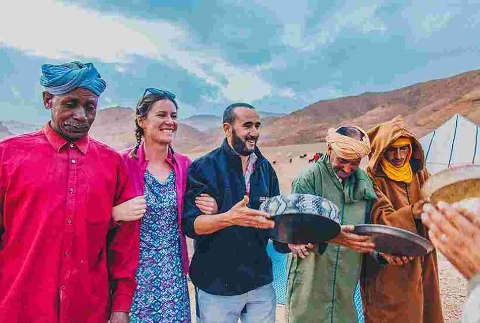 tourists enjoying traditional dance with a Moroccan Family
